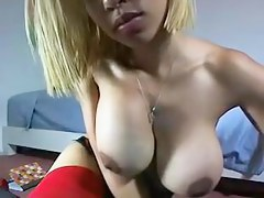 Busty blonde shows her big jugs