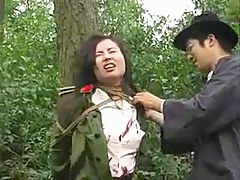 Chinese dragoon girl tied with regard to tree 1