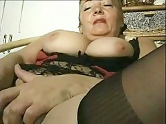 Nasty mature bitch plays with a big dildo