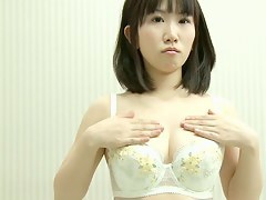 Fresh Asian takes off her dress and shows her sweet tits