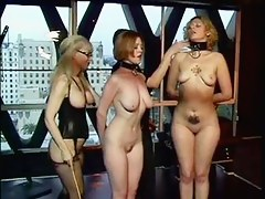 Two hot sluts taught to be submissive by a couple