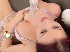 Beautiful brunette Carla Mai is lying on the couch is sexy bra and briefs and having wild masturbation session.